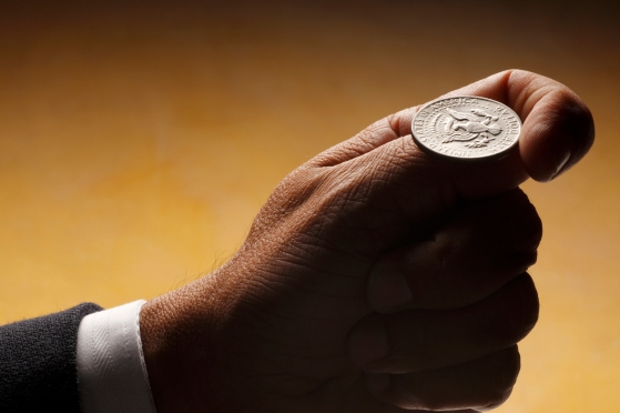 A businessman about to flip a coin